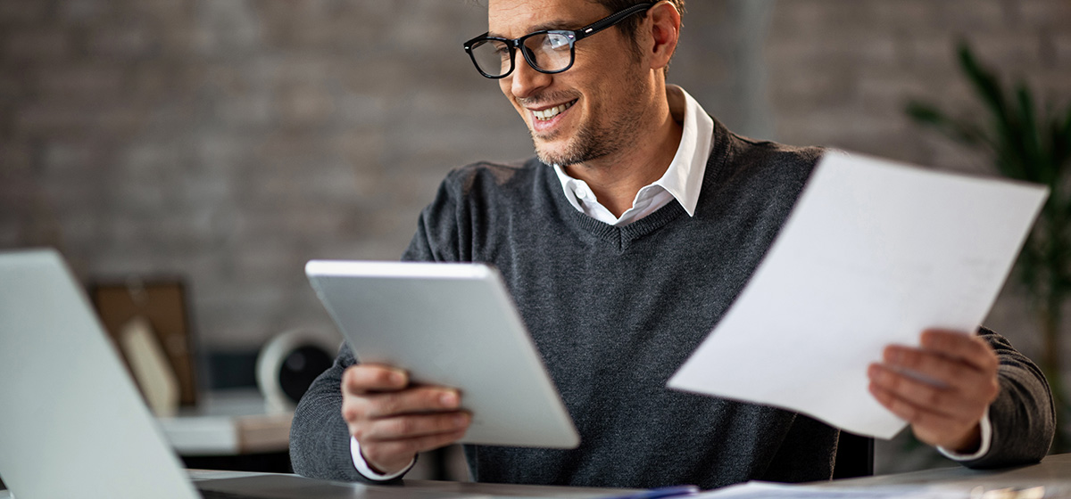 man searching for information on a computer